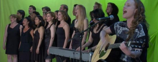 """Stephanie (far right, back row) singing in the upcoming feature film, """"Snow"""""""